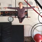 Rowan front balance on trapeze training space